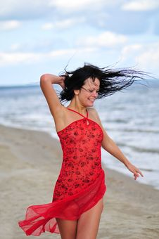 Free Happy Woman Dancing On The Beach Stock Photo - 6061620