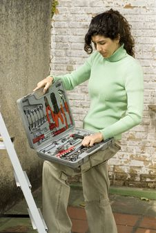 Free Woman Opens Toolkit - Golfers Laughing - Vertical Royalty Free Stock Image - 6062936