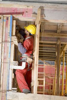 Free Worker Builds Wall - Vertical Stock Image - 6063121