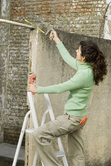 Woman Holding A Saw - Vertical Stock Image