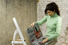 Free Woman Opens Toolkit - Horizontal Royalty Free Stock Photo - 6063325
