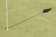 Shadow Of A Golf Green Flag Stock Photo