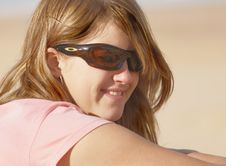 Young Girl With Smile And Sunglasses Stock Image