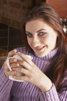 Free Smiling Girl Holding White Mug With Both Hands Stock Image - 6068701