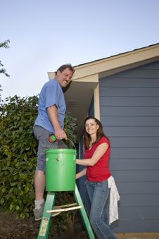 Free Man And Woman With A Bucket And Ladder - Vertical Stock Image - 6069271