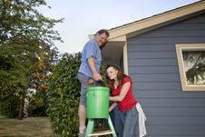 Couple With A Bucket And Ladder - Horizontal Stock Photos