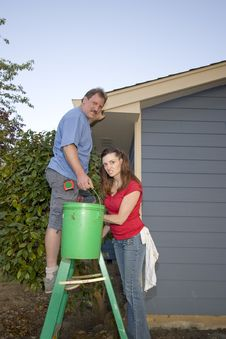 Free Man And Woman With A Bucket And Ladder - Vertical Royalty Free Stock Photos - 6069608