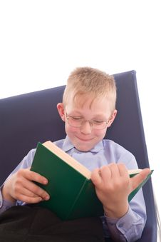 Free Boy Reading Interesting Book Royalty Free Stock Photos - 6069738