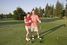 Free Couple Playing Golf - Horizontal Stock Photo - 6069740
