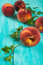 Free Peaches On Turquoise Table Royalty Free Stock Photography - 60621147