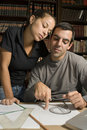 Free Couple Doing Paperwork - Vertical Stock Photo - 6077390