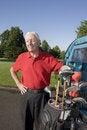 Free Man Next To Golf Cart Smiling Stock Photos - 6077713