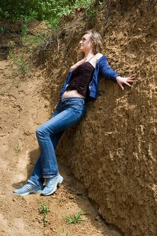 The Girl Near A Clay Wall Stock Image