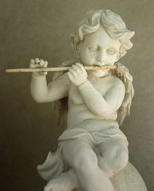 Free Old Figurine - Flute Playing Angel Royalty Free Stock Photos - 6073768