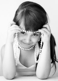 Girl Child With Bead Royalty Free Stock Image
