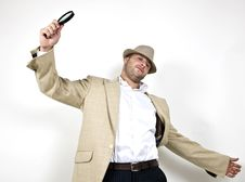 Man With Fedora Hat And Magnifier Royalty Free Stock Image