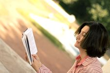 Free Pretty Woman Reading In Park Stock Photography - 6076912
