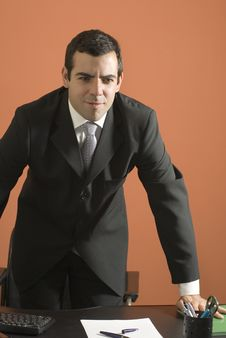 Businessman Standing Over His Desk - Vertical Royalty Free Stock Photos