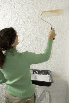 Woman Painting A Wall - Vertical Stock Images