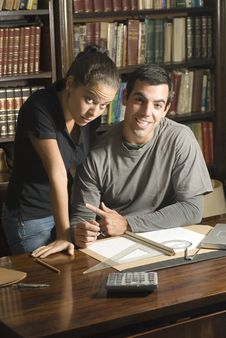 Free Couple Studying - Vertical Royalty Free Stock Photography - 6077357