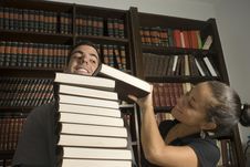 Free Couple Playing With Books - Vertical Royalty Free Stock Photo - 6077365