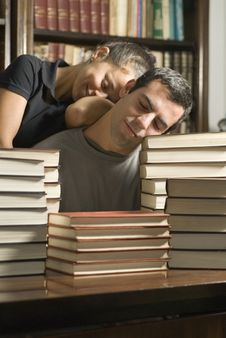 Free Couple Asleep On Books - Vertical Royalty Free Stock Photography - 6077367