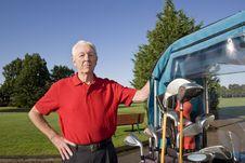 Free Man Next To Golf Cart Smiling Stock Images - 6077544