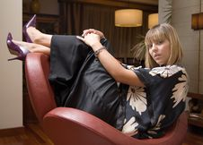 Free Beautiful Blonde Woman Sitting In An Armchair Royalty Free Stock Image - 6082546