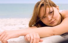 Free Woman Lying On The Beach Stock Photography - 6084142