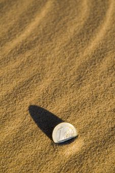 Free Euro Coin In The Sand Stock Photos - 6084873