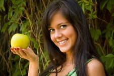 Free The Brunette With An Apple Stock Photo - 6085570