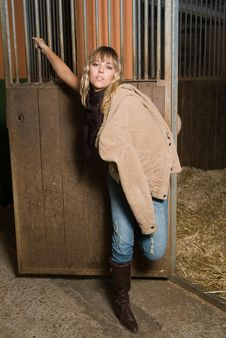 Fashion Cow Girl In A Horse Stable Royalty Free Stock Image