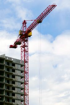 Building Crane Aganist Cloudy Sky And Building Und Stock Photos