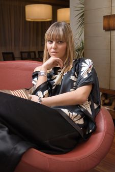 Free Beautiful And Fashion Woman Sitting In An Armchair Royalty Free Stock Photography - 6085827