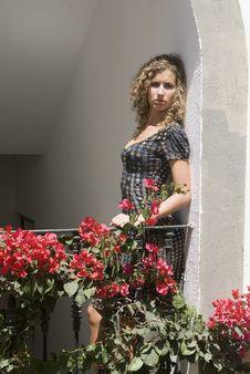 Free Beautiful Girl Waiting In An Spanish Balcony Stock Photography - 6086242