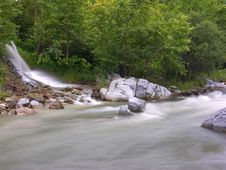 Free Falls Running Into The Mountain River Stock Photo - 6090060