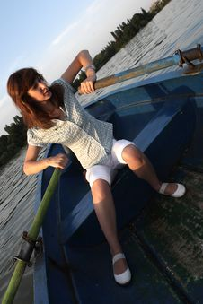 Free Girl Rowing Boat Stock Photography - 6091452
