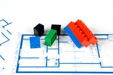 Free Blueprint For A House And Plastic Blocks Royalty Free Stock Photography - 6093077