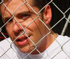 Free Man Behind A Fence Stock Photos - 6094783