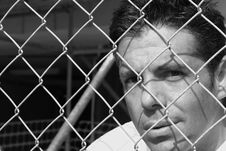 Free Man Behind A Fence Stock Images - 6094784