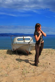 Free Young Woman With Boat Stock Photography - 6096502