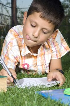 Free Boy Doing Home Work Stock Image - 6097421