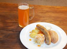 Free Sausages With Vegetables And Mug With Beer Stock Image - 60936621