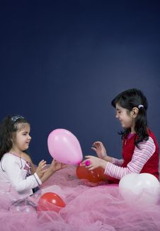 Free Girls Playing With Balloons Stock Photography - 619172