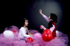 Girls Playing With Balloons Stock Photos
