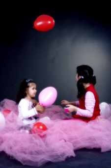 Girls Playing With Balloons Stock Images