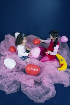 Free Girls Playing With Balloons Royalty Free Stock Photo - 619175