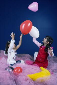 Free Young Girls Playing With Balloons Stock Photo - 619180