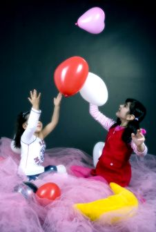 Young Girls Playing With Balloons Stock Image