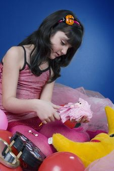 Young And Beautiful Girl Playing With Her Doll Stock Images